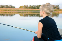 Girl is fishing. On a lake Stock Photography