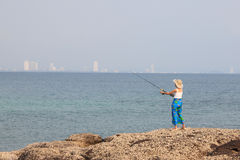 Girl fishing Royalty Free Stock Image