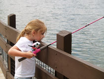 Girl fishing Stock Photography