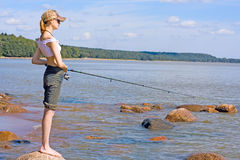 Girl fishing Stock Photos