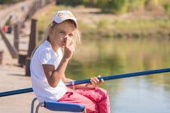Girl fishing calls for silence Stock Photos