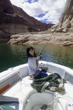 Girl fishing at lake powell Royalty Free Stock Image