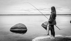 Girl fishing in monochrome Royalty Free Stock Photos