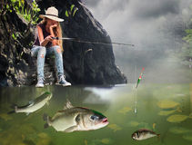 Girl fishing morning with lot of big fishes. Royalty Free Stock Photos