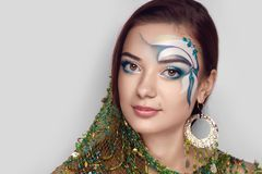 Girl with fishing net. Girl decorated with a cloth green fishing net. Creative make up new conceptual idea. colorful bold face-art body art painting lines Royalty Free Stock Photos
