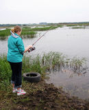 Girl with a fishing rod Royalty Free Stock Photos
