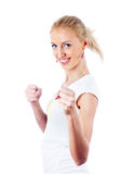 Girl with fists Royalty Free Stock Images