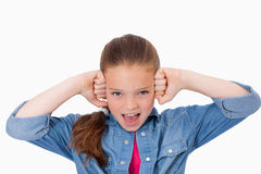 Girl with the fists on her face Royalty Free Stock Photo