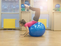 Girl and fit ball. Royalty Free Stock Photos