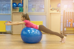 Girl and fit ball. Stock Images