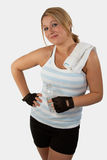 Girl fitness. Attractive blond hair young woman with blue eyes wearing workout attire holding a water bottle royalty free stock photos