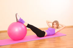 Girl with fitness ball Royalty Free Stock Photo