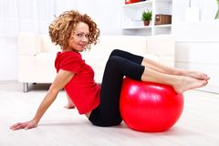 Girl with fitness ball Royalty Free Stock Photos