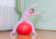 Girl with the fitness ball Royalty Free Stock Images