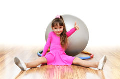 Girl  fitness-ball pink sport Royalty Free Stock Image