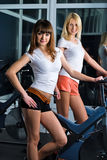 Girl in fitness center Stock Images