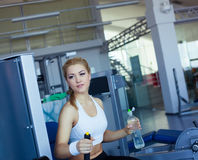 Girl in fitness club Stock Images