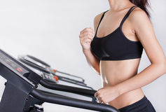 Girl in fitness club. Part of a body of the girl on a racetrack Royalty Free Stock Photography