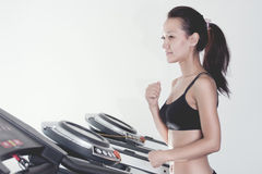 Girl in fitness club. Portrait of the Asian girl on a racetrack in fitness club Stock Photo