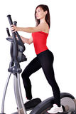 Girl fitness exercise. With cross trainer Royalty Free Stock Image