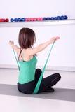 Girl fitness exercise backside Royalty Free Stock Photo