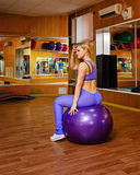Girl in fitness with fitball Royalty Free Stock Image