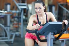 Girl in fitness hall Stock Images
