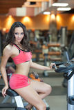 Girl in fitness hall Stock Photos