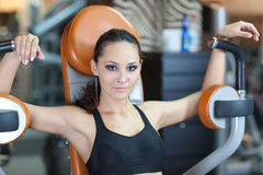 Girl in fitness hall Royalty Free Stock Images