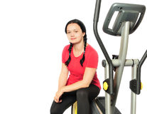 Girl with fitness machine Stock Images