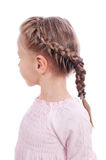 Beautiful girl with a pigtail. A girl of five years with a pigtail on a white background Royalty Free Stock Photography