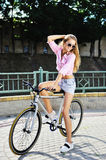 Girl on a fixed gear bicycle outdoor Stock Image