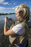 Girl fixed lure. Picture of angler fixed a lure - preparation to fishing stock photos