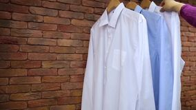 Shirts hanging on a rag in the store stock footage