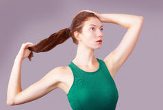 Girl fixes hair Stock Images