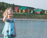 Girl flap hand. On background city lake Royalty Free Stock Photo