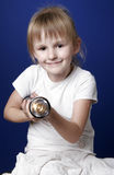 Girl with flash-light. Little girl hold long black electric flash-light Stock Images