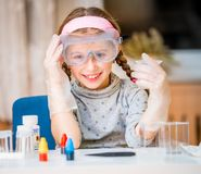 Girl with flasks for chemistry Royalty Free Stock Images