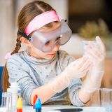 Girl with flasks for chemistry Stock Image