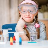 Girl with flasks for chemistry Stock Photography