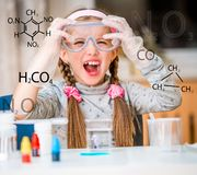 Girl with flasks for chemistry Stock Photos