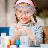 Girl with flasks for chemistry Royalty Free Stock Photo
