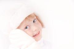 Girl in fleece hat. Little girl in white winter fleece hat & mittens portrait on white Royalty Free Stock Photo