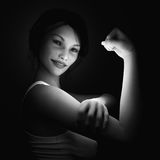 Girl flexing her muscles Royalty Free Stock Photos
