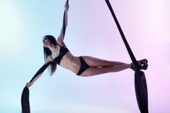 Girl flies acrobatic tissue Stock Photo