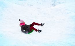 girl flies on a slide from an ice slide royalty free stock photos