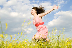 The girl in flight. The beautiful smiling young girl flies above a field Royalty Free Stock Images
