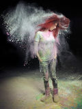 Girl Flinging Red Hair. Redhead girl with colored powder trailing behind her hair that she is flinging up Stock Images