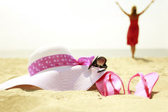 Girl with flip-flops on the beach Stock Photo