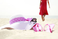 Girl with flip-flops on the beach. A girl with flip-flops on the beach Royalty Free Stock Image